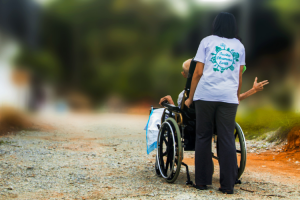A Guardianship of the Person case. A shot from behind of a young woman pushing her elderly relative in a wheelchair