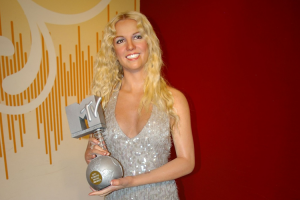 Britney Spears Conservatorship Blog Image: Britney wearing a silver dress and holding an MTV award.